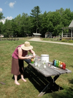 Rachel doing some Solar Kool-Aid dyeing on the picnic tables.