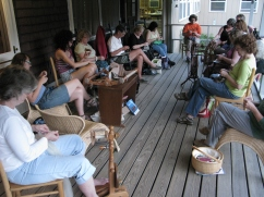 Knitting, spinning, and weaving on the porch.